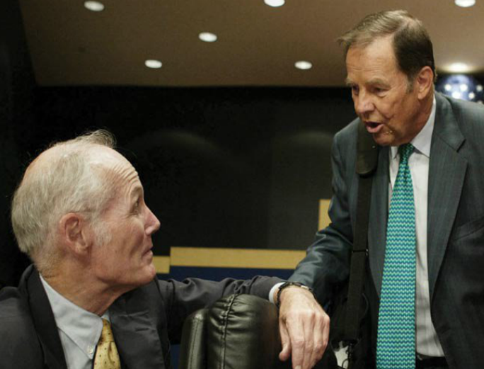 9/11 Commission member Slade Gorton (L) talks to Commission Chairman Thomas Kean before the start of a Commission hearing in Washington, DC, in 2004.